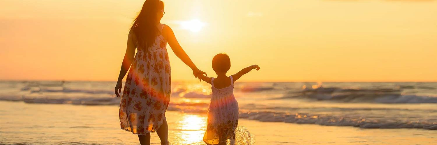 cost of raising a child - mother and child sunset photo
